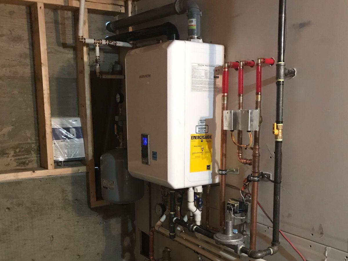 https://linkplumbing.ca/wp-content/uploads/2020/11/tankless-water-heater-burnaby.jpg